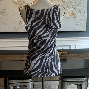 Cache Tops - Sequins and animal print. Size medium. Cache